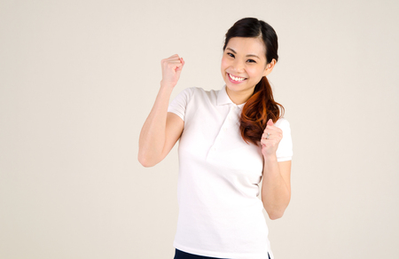 chinese lady: Portrait of an excited asian woman Stock Photo