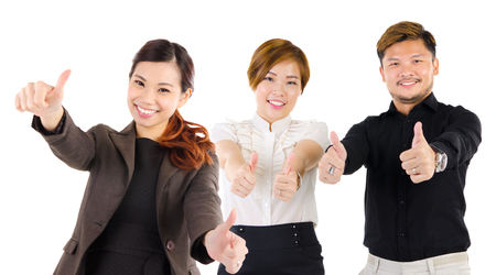 thumbs up group: Asian business executives raised their thumbs up