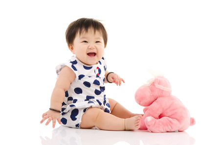 Indoor portrait of a cheerful asian baby