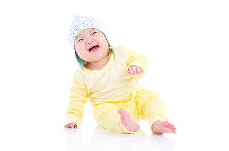 baby sitting: Asian baby sitting on the floor and laugh