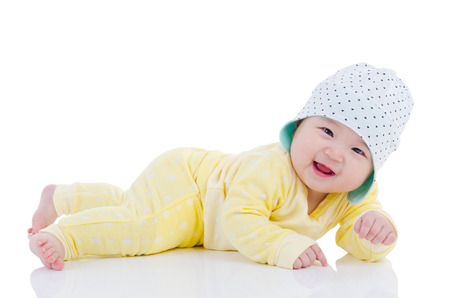 Asian baby lying on the floor and smile