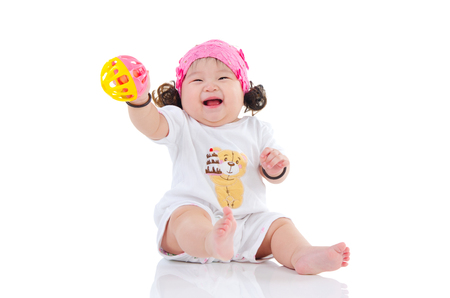 baby toys: Cheerful asian baby holding a toy Stock Photo