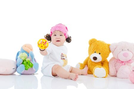 baby toys: Lovely asian baby playing with toys Stock Photo