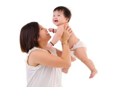 asia children: Asian mother lifting up her baby