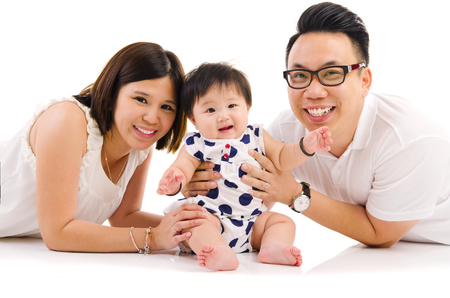 family with baby: Indoor portrait of asian family Stock Photo