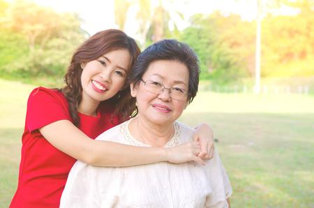 Outdoor portrait of asian senior woman and daughter Reklamní fotografie
