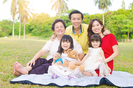 Outdoor portrait of a beautiful asian three generations family Stock Photo