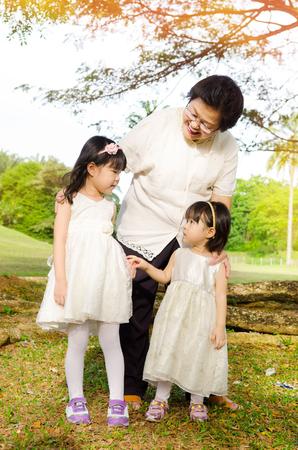 singaporean: Asian senior woman together with grandchildren