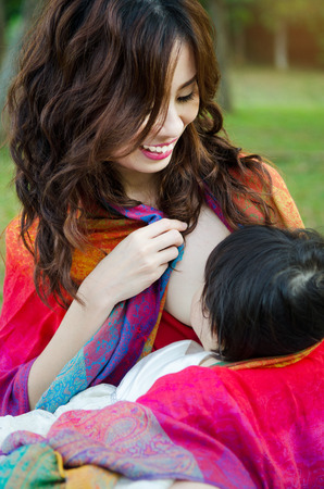 breastmilk: Asian woman breastfeeding her baby