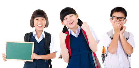 Cheerful asian primary student put books on her head