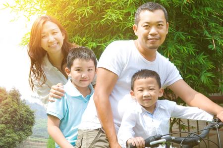 Asian family enjoy cycling