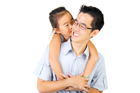 singaporean: Asian child kiss her father isolated on white background