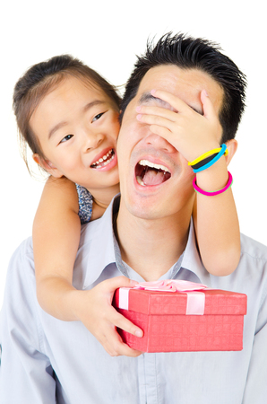 surprises: Asian girl giving surprise gift to her father on fathers day