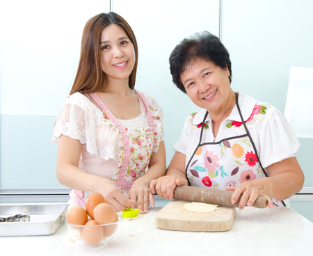 Asian senior woman and daughter prepare for baking in the kitchen Stock Photo