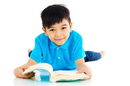 Asian boy lying on the floor and reading