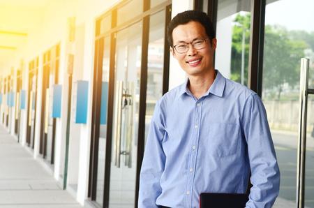 Portrait of a smiling asian businessman Фото со стока