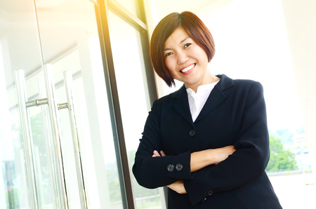 Middle aged confident asian businesswoman