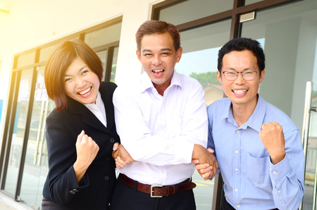 Asian business people celebrating victory