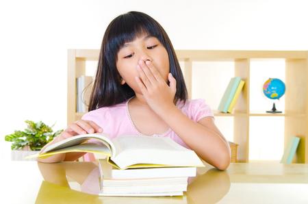 Asian girl yawning