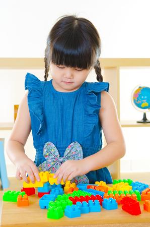 Asian kid playing building block