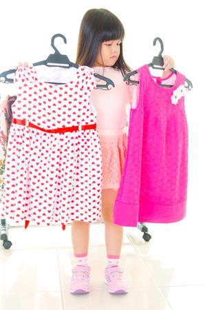 Asian kid choosing clothes