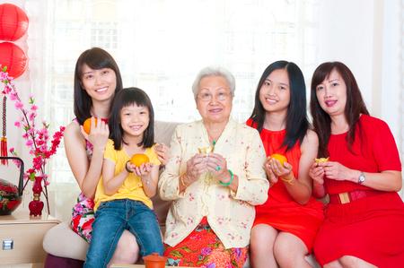 Asian three generations family celebrating chinese new year Фото со стока