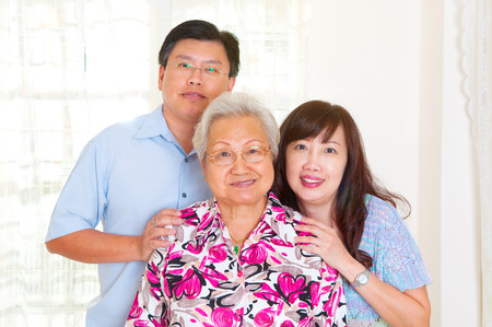 Portrait of asian senior woman together with son and daughter
