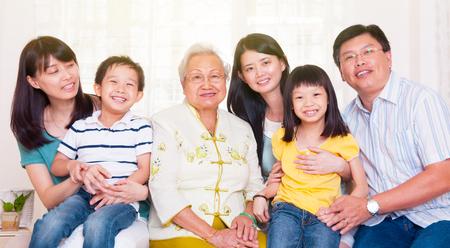 Cheerful asian three generations family