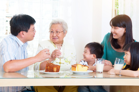 Asian three generations having breakfast