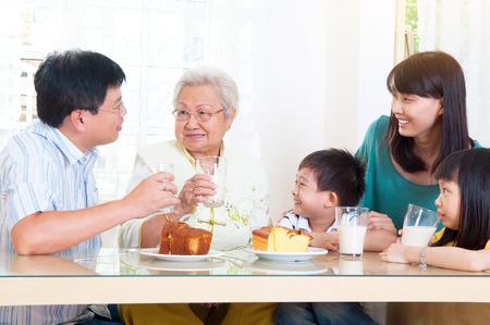 Asian three generations having breakfast