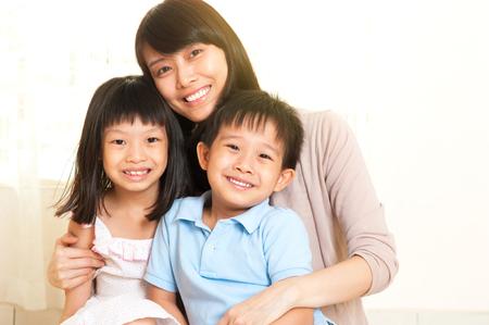 Beautiful asian mother and kids Фото со стока