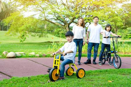 Asian family enjoyed outdoor activity in the park Фото со стока