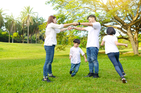 Asian family having fun in the park