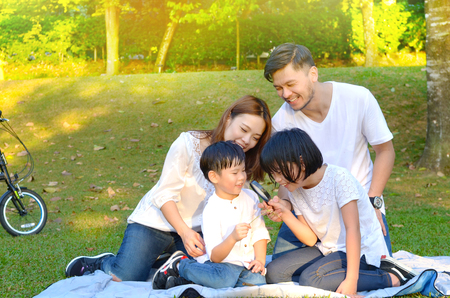 Beautiful asian family enjoyed outdoor nature at the park