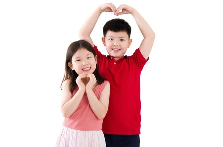 Asian boy and girl making love shape with hands