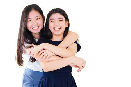Portrait of two happy asian girls
