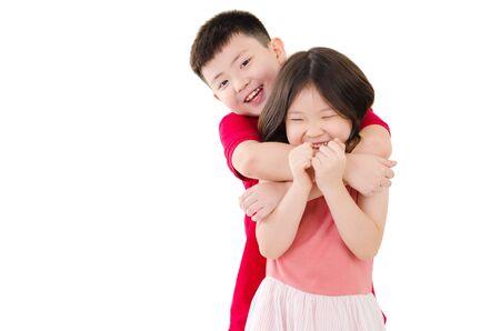 Lovely asian boy hug his sister