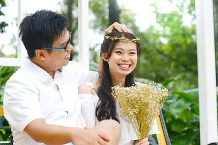 Lovely asian young couple laugh happily