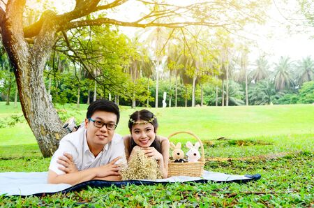 Asian young couple on picnic Stock Photo