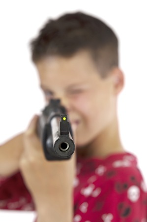 airgun: Boy pointing his airgun towards the camera  The focus is on the end of the barrel