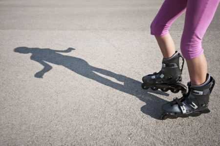 raised viewpoint: Roller skating girl Stock Photo