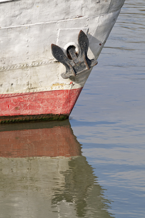 ship anchor: Sunny ship detail with anchor and water Stock Photo