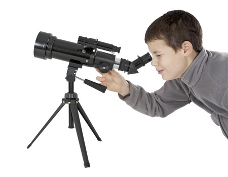 steadiness: Young man looking through an astronomy telescope on tripod