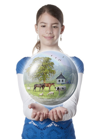 Young woman holding farm globe on isolated white background photo