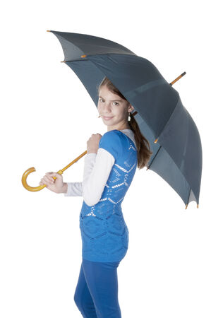 Young woman with umbrella on isolated white background photo