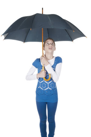 Young woman with umbrella looking up on isolated white background photo