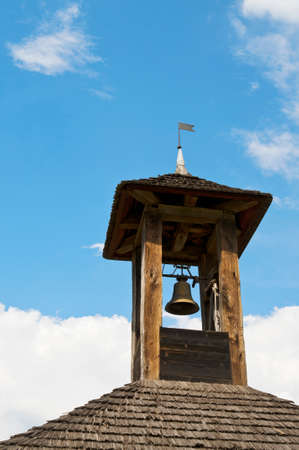 belfry: Wooden belfry with bell and nice sky Stock Photo
