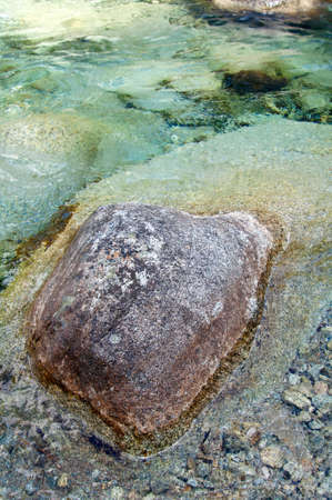 large rock: Top of large rock seen from the creek crystal clear water
