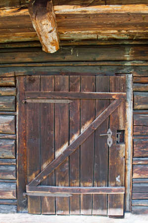 outhouse: Old wooden outhouse simple and small brown door