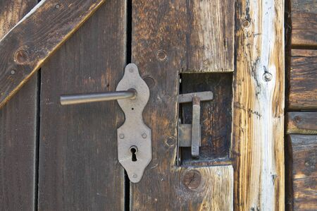 outhouse: Old wooden outhouse door lock details Stock Photo